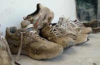 old muddy running shoes