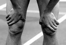 Runner exhausted bent over hands on knees