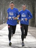 Two men running as pair
