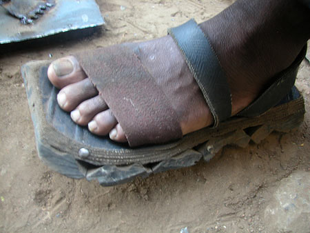 Shoes made from old tire and seat belt