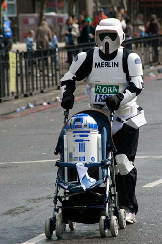 Storm trooper with R2D2 in stroller
